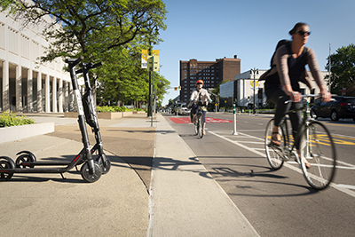 Students using city scooters to get through Detroit. Photo Credit: Michele Brautnick (SmithGroup)